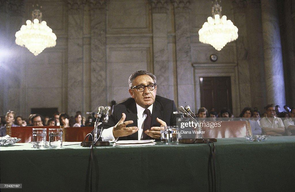Former US Secretary of State Henry Kissinger testifying before Senate Energy Committee.