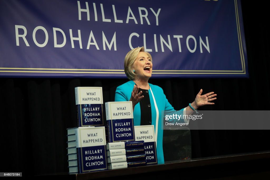 Former U.S. Secretary of State Hillary Clinton acknowledges the audience as she arrives onstage to sign copies of her new book 'What Happened' during an event at Barnes and Noble bookstore, September 12, 2017 in New York City. Clinton's book, which focuses on her 2016 election loss to President Donald Trump, goes on sale today.