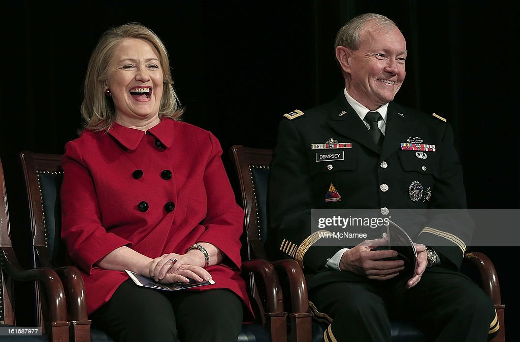 Former U.S. Secretary of State <a gi-track='captionPersonalityLinkClicked' href=/galleries/search?phrase=Hillary+Clinton&family=editorial&specificpeople=76480 ng-click='$event.stopPropagation()'>Hillary Clinton</a> and Chairman of the Joint Chiefs of Staff <a gi-track='captionPersonalityLinkClicked' href=/galleries/search?phrase=Martin+Dempsey&family=editorial&specificpeople=2116621 ng-click='$event.stopPropagation()'>Martin Dempsey</a> laugh during remarks by U.S. Defense Secretary Leon Panetta at a presentation ceremony for the Department of Defense's highest award for public service at the Pentagon February 14, 2013 in Arlington, Virginia. Secretary Clinton recently retired from public service.