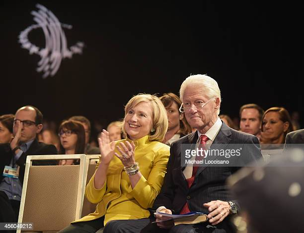 Former US Secretary of State Hillary Clinton and husband Former US President Bill Clinton attend the Closing Plenary Session 'Aiming for the Moon and...