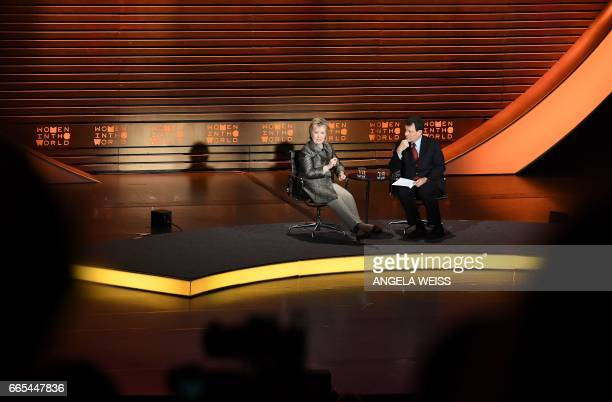 Former US Secretary of State Hillary Clinton and Journalist Nicholas Kristof speak at the Eighth Annual Women in the World Summit at Lincoln Center...