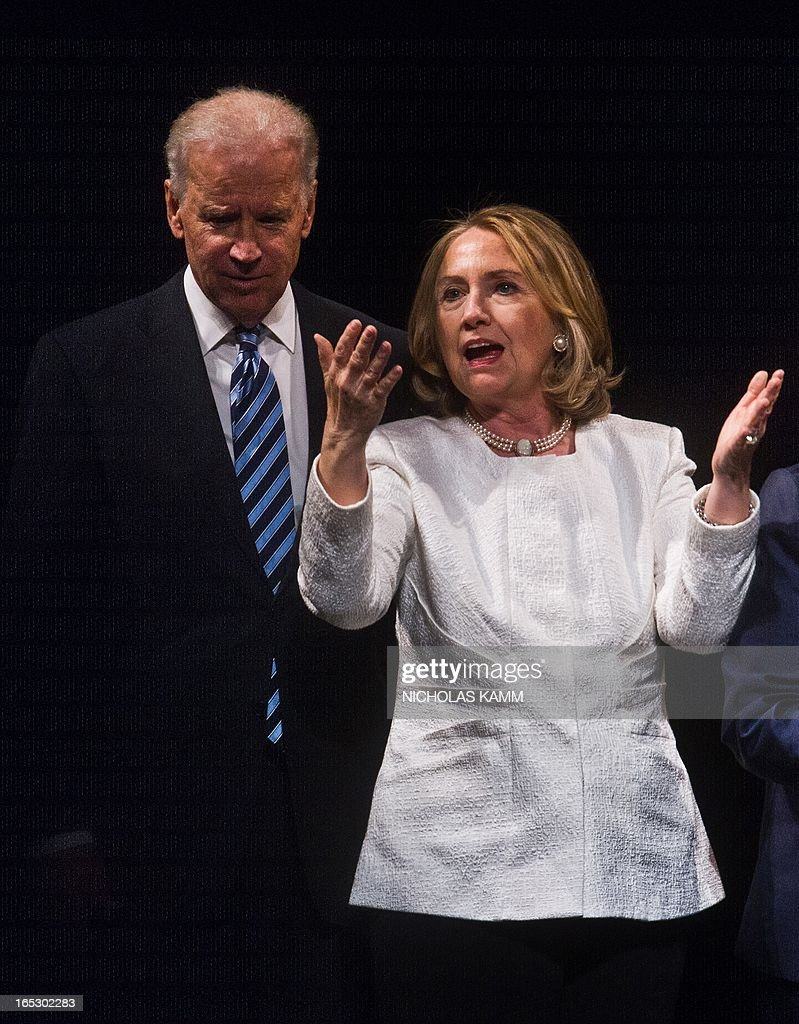 Former US Secretary of State Hillary Clinton and Vice President Joe Biden speak at the end of the Vital Voices Global Awards ceremony at the Kennedy Center in Washington on April 2, 2013. The event honors 'women leaders from around the world who are the unsung heroines to strengthen democracy, increase economic opportunity, and protect human rights,' according to the group's website. AFP PHOTO/Nicholas KAMM