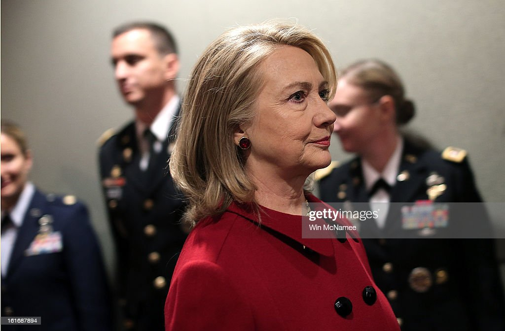 Former U.S. Secretary of State <a gi-track='captionPersonalityLinkClicked' href=/galleries/search?phrase=Hillary+Clinton&family=editorial&specificpeople=76480 ng-click='$event.stopPropagation()'>Hillary Clinton</a> arrives for a presentation ceremony for the Department of Defense's highest award for public service at the Pentagon February 14, 2013 in Arlington, Virginia. Secretary Clinton recently retired from public service.