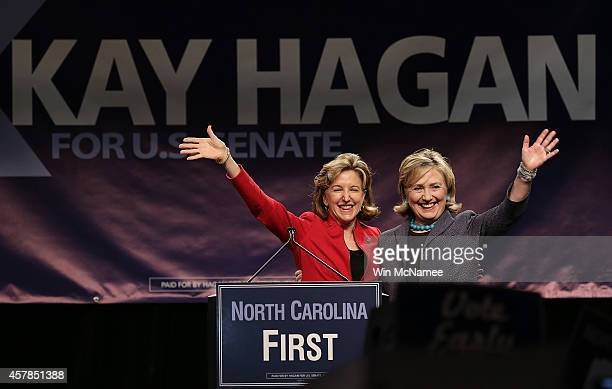 Former US Secretary of State Hillary Clinton campaigns for Sen Kay Hagan at a 'Vote Early' rally October 25 2014 in Charlotte North Carolina With ten...
