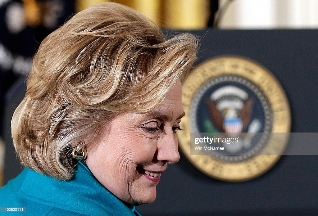 Former U.S. Secretary of State <a gi-track='captionPersonalityLinkClicked' href=/galleries/search?phrase=Hillary+Clinton&family=editorial&specificpeople=76480 ng-click='$event.stopPropagation()'>Hillary Clinton</a> greets guests before U.S. President Barack Obama awarded former U.S. President Bill Clinton the Presidential Medal of Freedom in the East Room at the White House on November 20, 2013 in Washington, DC. The Presidential Medal of Freedom is the nation's highest civilian honor, presented to individuals who have made meritorious contributions to the security or national interests of the United States, to world peace, or to cultural or other significant public or private endeavors.