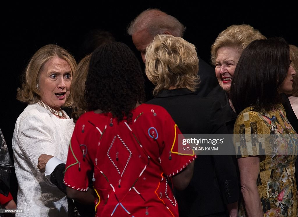 Former US Secretary of State Hillary Clinton (L) greets participants at the end of the Vital Voices Global Awards ceremony at the Kennedy Center in Washington on April 2, 2013. The event honors 'women leaders from around the world who are the unsung heroines to strengthen democracy, increase economic opportunity, and protect human rights,' according to the group's website. AFP PHOTO/Nicholas KAMM