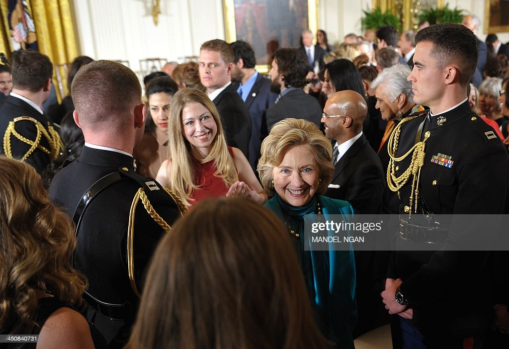 Former US secretary of state Hillary Clinton (R), her daughter Chelsea Clinton (2nd R) and Clinton personal aide Huma Abedin (behind) make their way from the East Room following the Medal of Freedom presentation ceremony at the White House on November 20, 2013 in Washington, DC. The Medal of Freedom is the country's highest civilian honor. AFP PHOTO/Mandel NGAN