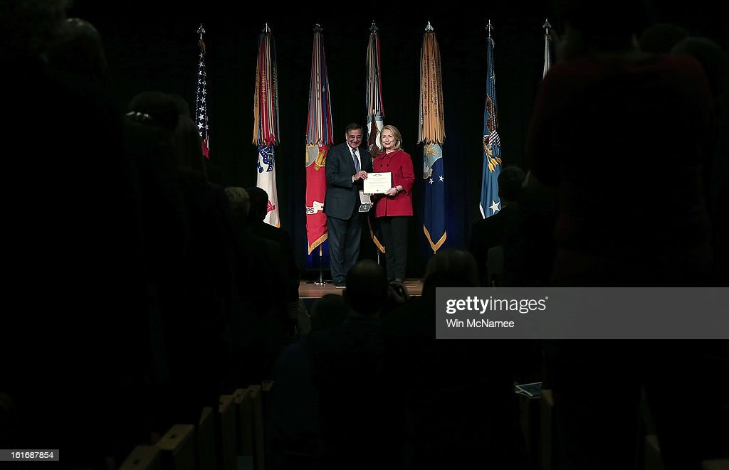 Former U.S. Secretary of State Hillary Clinton (R) is presented with the Department of Defense's highest award for public service by U.S. Secretary of Defense Leon Panetta at the Pentagon February 14, 2013 in Arlington, Virginia. Secretary Clinton recently retired from public service.
