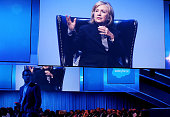 Former US Secretary of State Hillary Clinton is projected on a video screen as she delivers a keynote address during the 2014 DreamForce conference...
