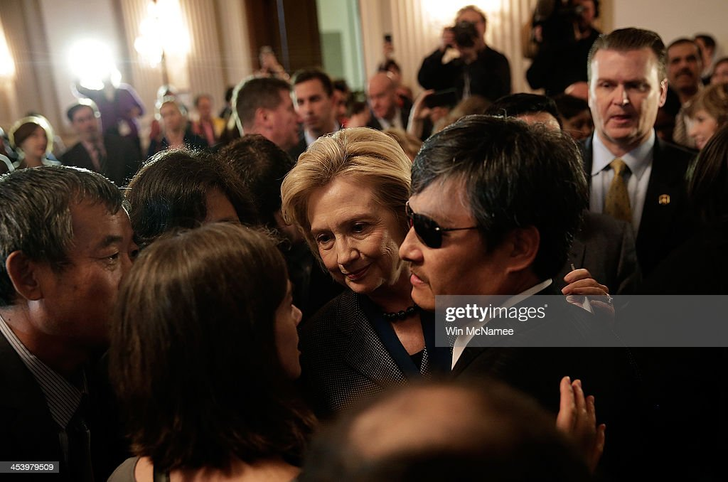 Former US Secretary of State Hillary Clinton recipient of the 2013 Tom Lantos Human Rights Prize greets the 2012 recipient Chinese dissident Chen...