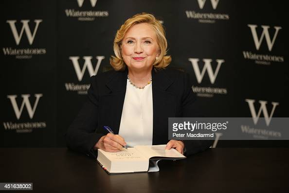 Former US Secretary of State Hillary Clinton signs copies of her new book at Waterstones bookshop on July 3 2014 in London England Mrs Clinton's book...