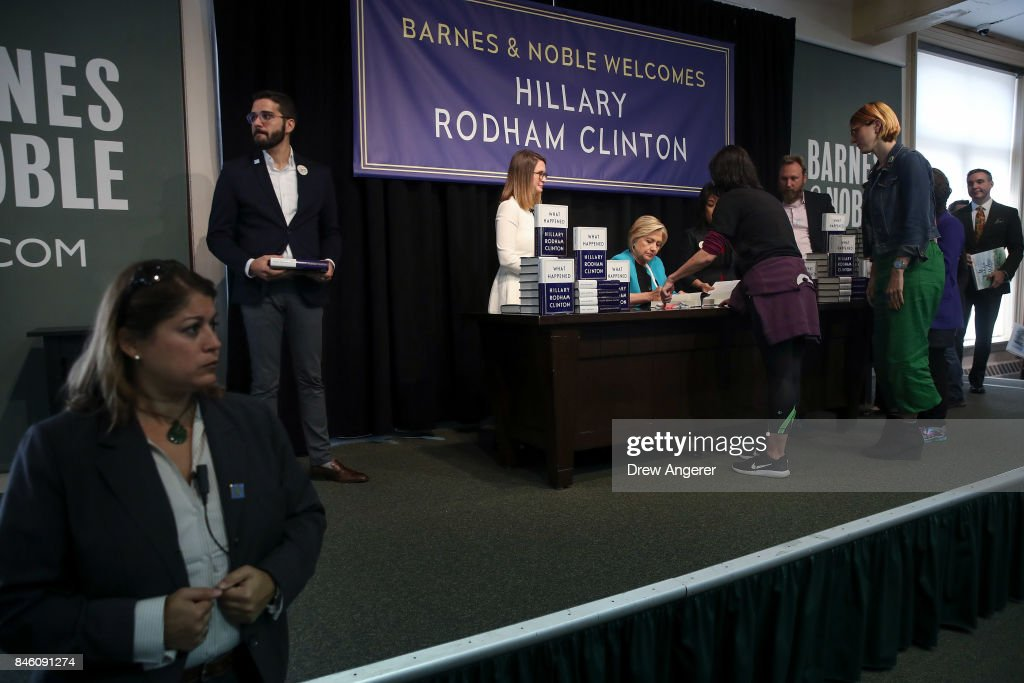 Former U.S. Secretary of State Hillary Clinton signs copies of her new book 'What Happened' during a book signing event at Barnes and Noble bookstore, September 12, 2017 in New York City. Clinton's book, which focuses on her 2016 election loss to President Donald Trump, goes on sale today.