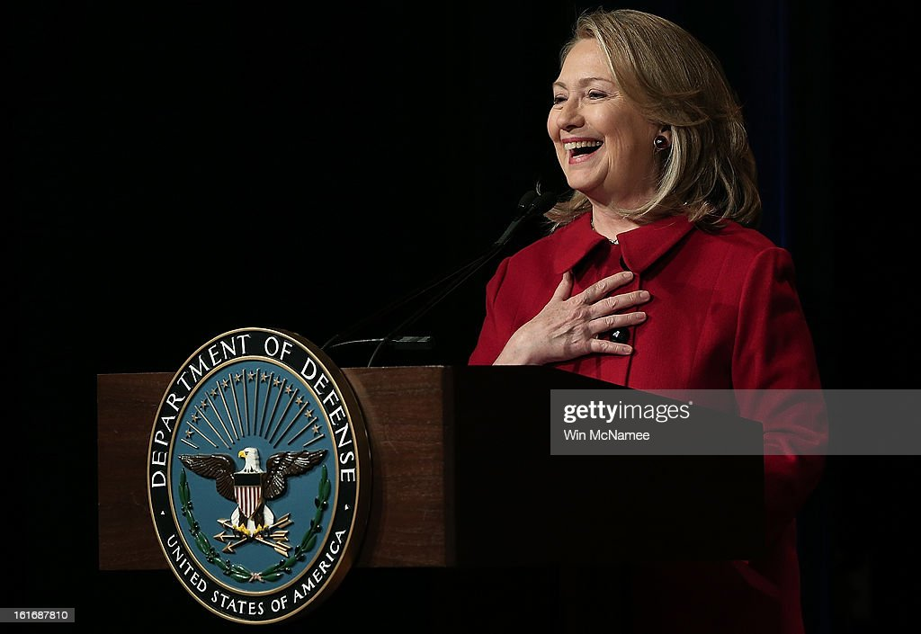 Former U.S. Secretary of State <a gi-track='captionPersonalityLinkClicked' href=/galleries/search?phrase=Hillary+Clinton&family=editorial&specificpeople=76480 ng-click='$event.stopPropagation()'>Hillary Clinton</a> speaks after being presented the Department of Defense's highest award for public service at the Pentagon February 14, 2013 in Arlington, Virginia. Secretary Clinton recently retired from public service.