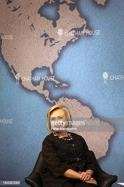 Former US Secretary of State Hillary Clinton waits to answer questions from an audience at Chatham House on October 11 2013 in London England Mrs...