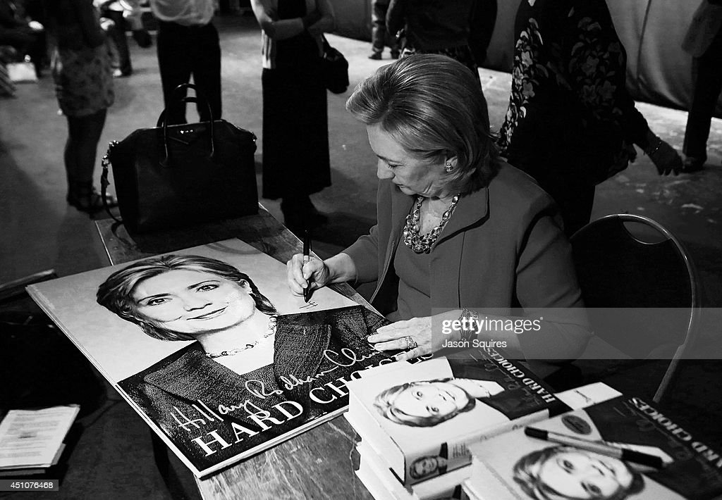 Former US Secretary of State Hillary Rodham Clinton signs copies of her book 'Hard Choices' after Rainy Day Book Presents Hillary Rodham Clinton at Arvest Bank Theatre at The Midland on June 22, 2014 in Kansas City, Missouri.