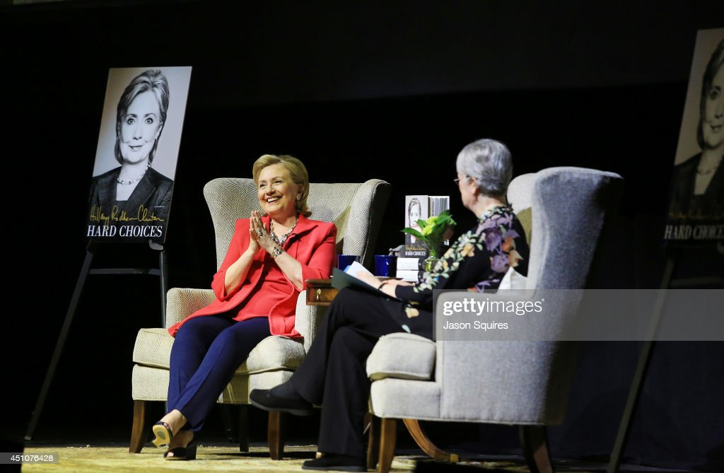 Former US Secretary of State Hillary Rodham Clinton (L) speaks about hew new book 'Hard Choices' during Rainy Day Book Presents Hillary Rodham Clinton at Arvest Bank Theatre at The Midland on June 22, 2014 in Kansas City, Missouri.