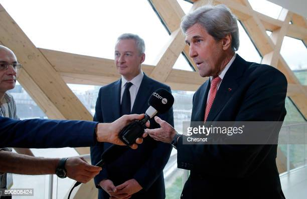 Former US Secretary of State John Kerry makes a statement next to French Economy Minister Bruno Le Maire prior to a cession on the theme 'Green...