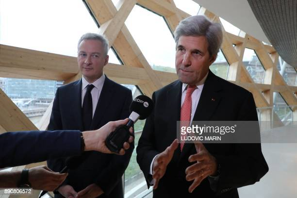 Former US secretary of state John Kerry speaks to journalists next to French Minister of Economy and Finance Bruno Le Maire during the One Planet...