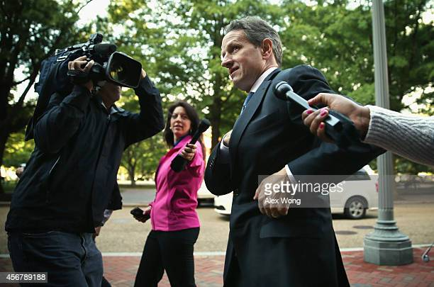 Former US Secretary of the Treasury Timothy Geithner is surrounded by members of the media as he arrives at US Court of Federal Claims to testify at...