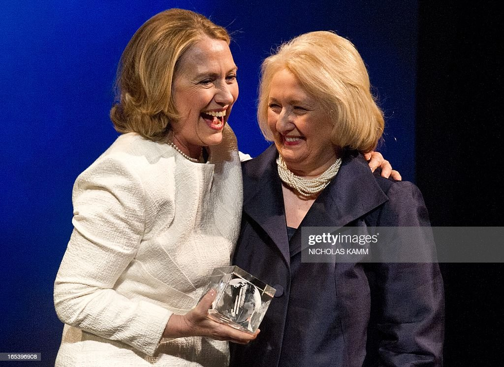 Former US Sectretary of State Hillary Clinton (L) greets former Ambassador-at-Large for Global Women's Issues and Vital Voices' Chair Emiritus Melanne Verveer on stage as she receives Special Tribute at the Vital Voices Global Awards ceremony at the Kennedy Center in Washington on April 2, 2013. The event honors 'women leaders from around the world who are the unsung heroines to strengthen democracy, increase economic opportunity, and protect human rights,' according to the group's website. AFP PHOTO/Nicholas KAMM