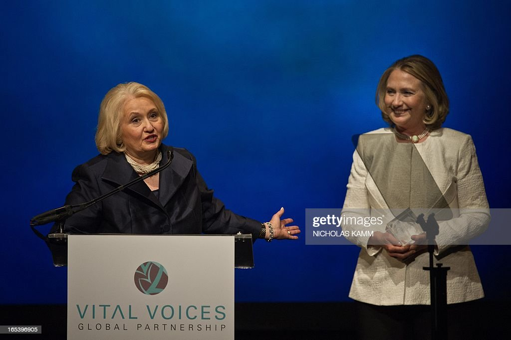 Former US Sectretary of State Hillary Clinton (R) listens to former Ambassador-at-Large for Global Women's Issues and Vital Voices' Chair Emiritus Melanne Verveer accept her Special Tribute at the Vital Voices Global Awards ceremony at the Kennedy Center in Washington on April 2, 2013. The event honors 'women leaders from around the world who are the unsung heroines to strengthen democracy, increase economic opportunity, and protect human rights,' according to the group's website. AFP PHOTO/Nicholas KAMM