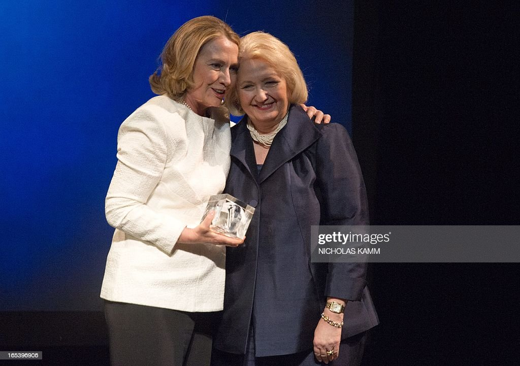 Former US Sectretary of State Hillary Clinton (L) poses with former Ambassador-at-Large for Global Women's Issues and Vital Voices' Chair Emiritus Melanne Verveer on stage as she receives Special Tribute at the Vital Voices Global Awards ceremony at the Kennedy Center in Washington on April 2, 2013. The event honors 'women leaders from around the world who are the unsung heroines to strengthen democracy, increase economic opportunity, and protect human rights,' according to the group's website. AFP PHOTO/Nicholas KAMM