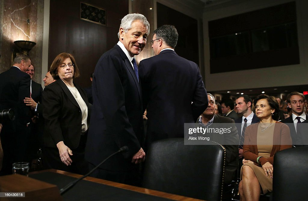 Former U.S. Sen. Chuck Hagel (R-NE) (C) arrives at his confirmation hearing to become the next secretary of defense before the Senate Armed Services Committee as his wife Lilibet (R) looks on January 31, 2013 on Capitol Hill in Washington, DC. President Barack Obama nominated Hagel, a controversial choice as Hagel opposed former President George W. Bush and his own party on the Iraq War and upset liberals with his criticism of a gay ambassador, for which he later apologized.