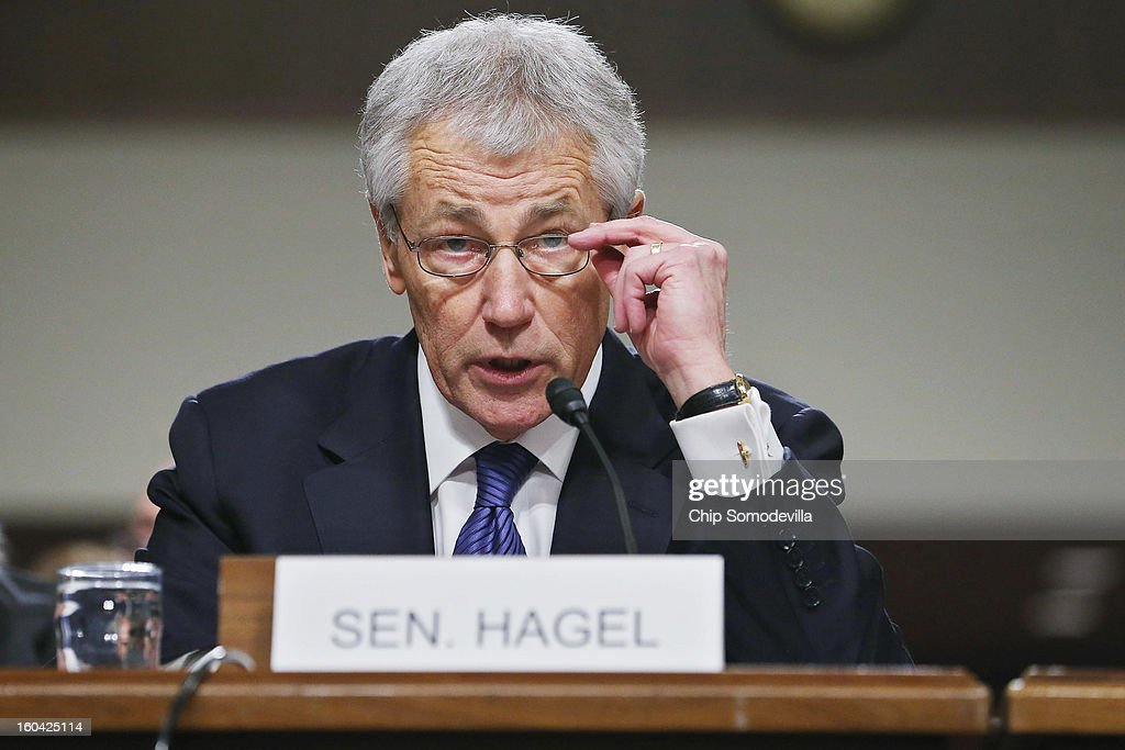 Former U.S. Sen. Chuck Hagel (R-NE) delivers opening remarks to the Senate Armed Services Committee during his confirmation hearing to become the next secretary of defense on Capitol Hill January 31, 2013 in Washington, DC. President Barack Obama nominated Hagel, a controversial choice as Hagel opposed former President George W. Bush and his own party on the Iraq War and upset liberals with his criticism of a gay ambassador, for which he later apologized.