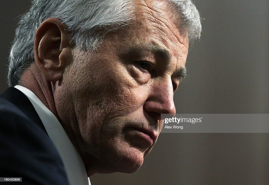 Former U.S. Sen. Chuck Hagel (R-NE) pauses as he testifies before the Senate Armed Services Committee during his confirmation hearing to become the next secretary of defense on Capitol Hill January 31, 2013 in Washington, DC. President Barack Obama nominated Hagel, a controversial choice as Hagel opposed former President George W. Bush and his own party on the Iraq War and upset liberals with his criticism of a gay ambassador, for which he later apologized.