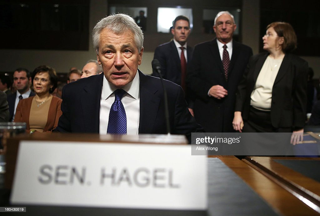 Former U.S. Sen. Chuck Hagel (R-NE) takes his seat as he arrives at his confirmation hearing to become the next secretary of defense before the Senate Armed Services Committee on Capitol Hill January 31, 2013 in Washington, DC. President Barack Obama nominated Hagel, a controversial choice as Hagel opposed former President George W. Bush and his own party on the Iraq War and upset liberals with his criticism of a gay ambassador, for which he later apologized.