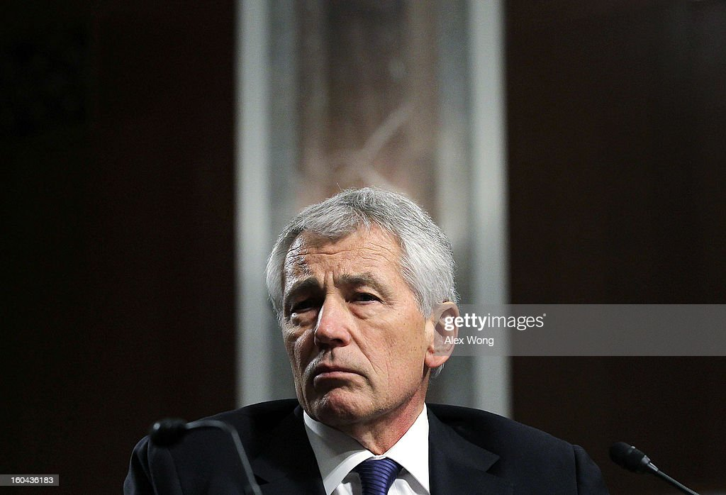 Former U.S. Sen. <a gi-track='captionPersonalityLinkClicked' href=/galleries/search?phrase=Chuck+Hagel&family=editorial&specificpeople=504963 ng-click='$event.stopPropagation()'>Chuck Hagel</a> (R-NE) testifies before the Senate Armed Services Committee during his confirmation hearing to become the next secretary of defense on Capitol Hill January 31, 2013 in Washington, DC. President Barack Obama nominated Hagel, a controversial choice as Hagel opposed former President George W. Bush and his own party on the Iraq War and upset liberals with his criticism of a gay ambassador, for which he later apologized.