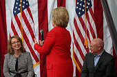 Former US Sen Gabrielle Giffords and her husband US Navy captain Mark Kelly look on as democratic presidential candidate former Secretary of State...