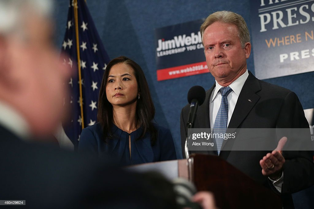 Former U.S. Sen. <a gi-track='captionPersonalityLinkClicked' href=/galleries/search?phrase=Jim+Webb&family=editorial&specificpeople=3986302 ng-click='$event.stopPropagation()'>Jim Webb</a> (D-VA) speaks as his wife Hong Le Webb listens during a news conference at the National Press Club October 20, 2015 in Washington, DC. Sen. Webb announced that he is dropping out of the Democratic presidential race.