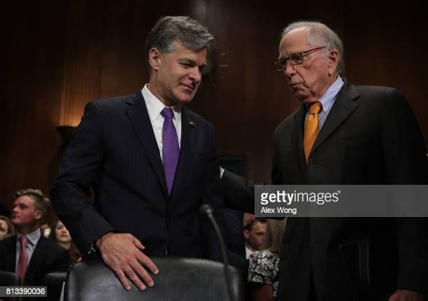 Former US Sen Sam Nunn and FBI Director nominee Christopher Wray share a moment prior to the confirmation hearing of Wray before the Senate Judiciary...