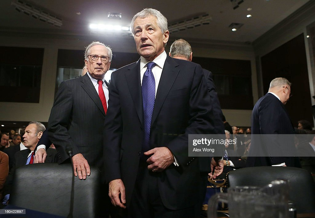 Former U.S. Senator Chuck Hagel (R-NE) (2nd L) arrives at his confirmation hearing to become the next secretary of defense before the Senate Armed Services Committee as former Senator Sam Nunn (D-GA) (L) looks on January 31, 2013 on Capitol Hill in Washington, DC. President Barack Obama nominated Hagel, a controversial choice as Hagel opposed former President George W. Bush and his own party on the Iraq War and upset liberals with his criticism of a gay ambassador, for which he later apologized.