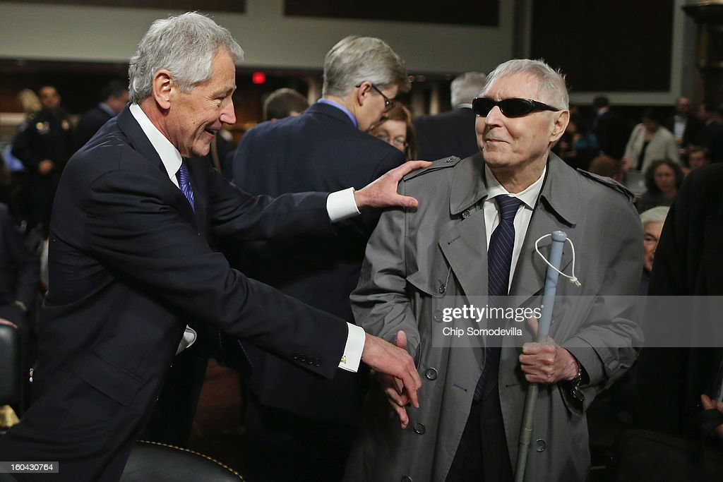 Former U.S. Senator Chuck Hagel (R-NE) greets fellow Vietnam War veteran John Fales during Hagel's confirmation hearing to become the next secretary of defense before the Senate Armed Services Committee on Capitol Hill January 31, 2013 in Washington, DC. President Barack Obama nominated Hagel, a controversial choice as Hagel opposed former President George W. Bush and his own party on the Iraq War and upset liberals with his criticism of a gay ambassador, for which he later apologized.
