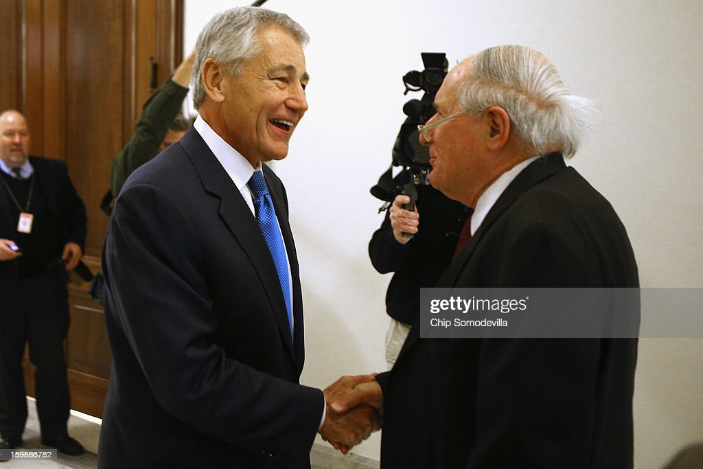 Former U.S. Senator <a gi-track='captionPersonalityLinkClicked' href=/galleries/search?phrase=Chuck+Hagel&family=editorial&specificpeople=504963 ng-click='$event.stopPropagation()'>Chuck Hagel</a> (L) greets Senate Armed Services Committee Chairman <a gi-track='captionPersonalityLinkClicked' href=/galleries/search?phrase=Carl+Levin&family=editorial&specificpeople=208878 ng-click='$event.stopPropagation()'>Carl Levin</a> (D-MI) after Hagel met with Sen. John McCain (R-AZ) on Capitol Hill January 22, 2013 in Washington, DC. Hagel, who cochaired McCain's 2000 presidential campaign, has been nominated by U.S. President Barack Obama to succeed Leon Panetta as Secretary of Defense.