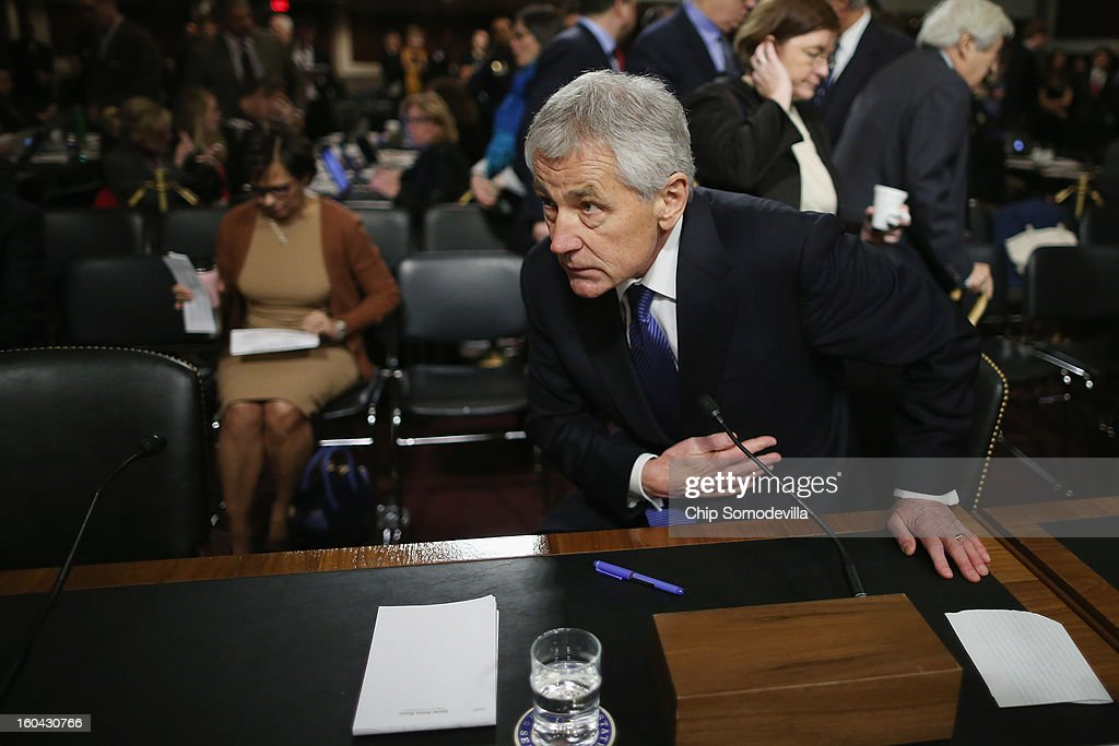 Former U.S. Senator Chuck Hagel (R-NE) returns to his confirmation hearing to become the next secretary of defense before the Senate Armed Services Committee on Capitol Hill January 31, 2013 in Washington, DC. President Barack Obama nominated Hagel, a controversial choice as Hagel opposed former President George W. Bush and his own party on the Iraq War and upset liberals with his criticism of a gay ambassador, for which he later apologized.