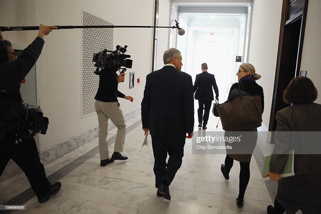 Former U.S. Senator <a gi-track='captionPersonalityLinkClicked' href=/galleries/search?phrase=Chuck+Hagel&family=editorial&specificpeople=504963 ng-click='$event.stopPropagation()'>Chuck Hagel</a> (C) talks with CIA Spokesperson Mare Harf after meeting with Sen. John McCain (R-AZ) on Capitol Hill January 22, 2013 in Washington, DC. Hagel, who cochaired McCain's 2000 presidential campaign, has been nominated by U.S. President Barack Obama to succeed Leon Panetta as Secretary of Defense.