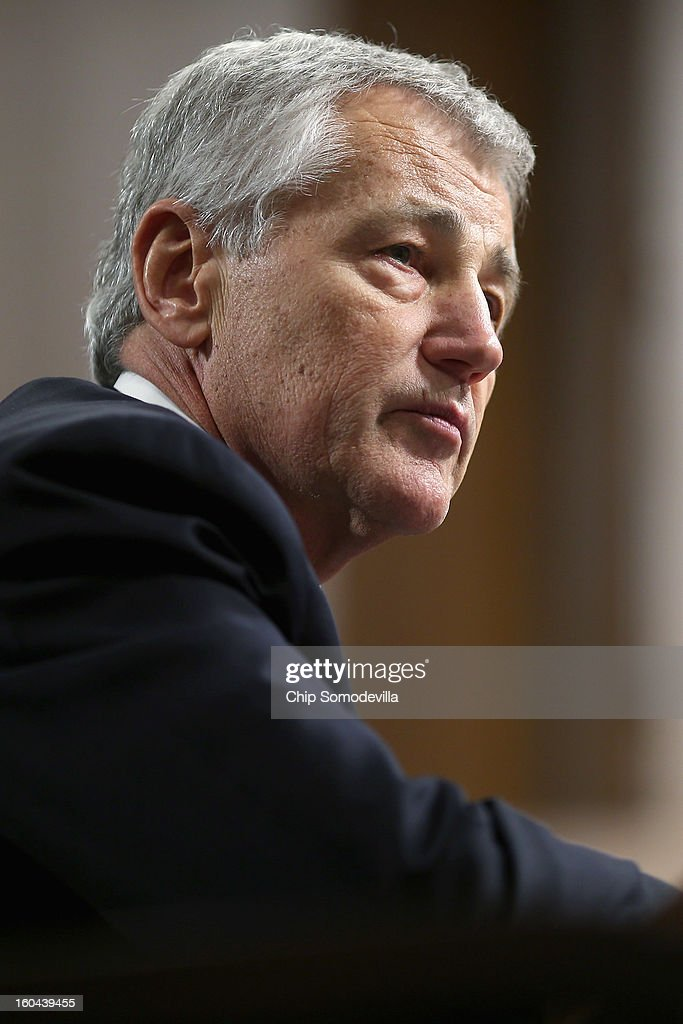 Former U.S. Senator <a gi-track='captionPersonalityLinkClicked' href=/galleries/search?phrase=Chuck+Hagel&family=editorial&specificpeople=504963 ng-click='$event.stopPropagation()'>Chuck Hagel</a> (R-NE) testifies before the Senate Armed Services Committee during his confirmation hearing to become the next secretary of defense on Capitol Hill January 31, 2013 in Washington, DC. President Barack Obama nominated Hagel, a controversial choice as Hagel opposed former President George W. Bush and his own party on the Iraq War and upset liberals with his criticism of a gay ambassador, for which he later apologized.