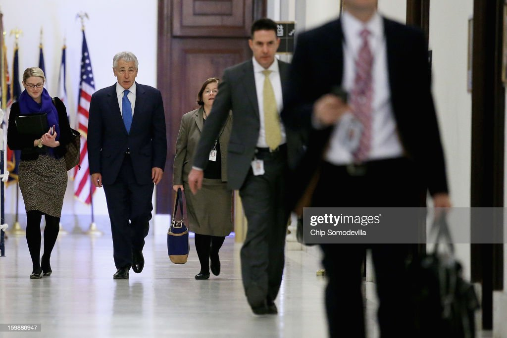 Former U.S. Senator Chuck Hagel (2nd L) walks down the hallway of the Russell Senate Office Building with CIA Spokesperson Marie Harf (L) and Assistant Secretary of Defense for Legislative Affairs Elizabeth King before meeting with Sen. John McCain (R-AZ) on Capitol Hill January 22, 2013 in Washington, DC. Hagel, who cochaired McCain's 2000 presidential campaign, has been nominated by U.S. President Barack Obama to succeed Leon Panetta as Secretary of Defense.
