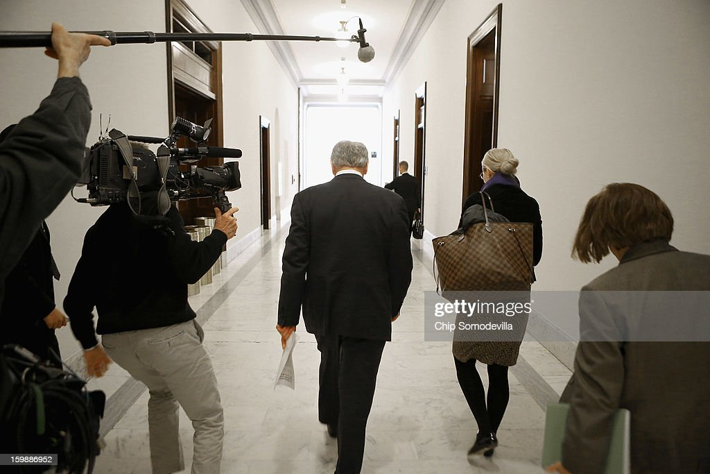 Former U.S. Senator <a gi-track='captionPersonalityLinkClicked' href=/galleries/search?phrase=Chuck+Hagel&family=editorial&specificpeople=504963 ng-click='$event.stopPropagation()'>Chuck Hagel</a> (C) walks down the hallway of the Russell Senate Office Building after meeting with Sen. John McCain (R-AZ) on Capitol Hill January 22, 2013 in Washington, DC. Hagel, who cochaired McCain's 2000 presidential campaign, has been nominated by U.S. President Barack Obama to succeed Leon Panetta as Secretary of Defense.