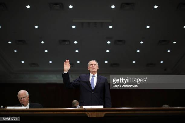 Former US Senator Dan Coats is sworn in during his confirmation hearing before the Senate Select Intelligence Committee to be the next Director of...