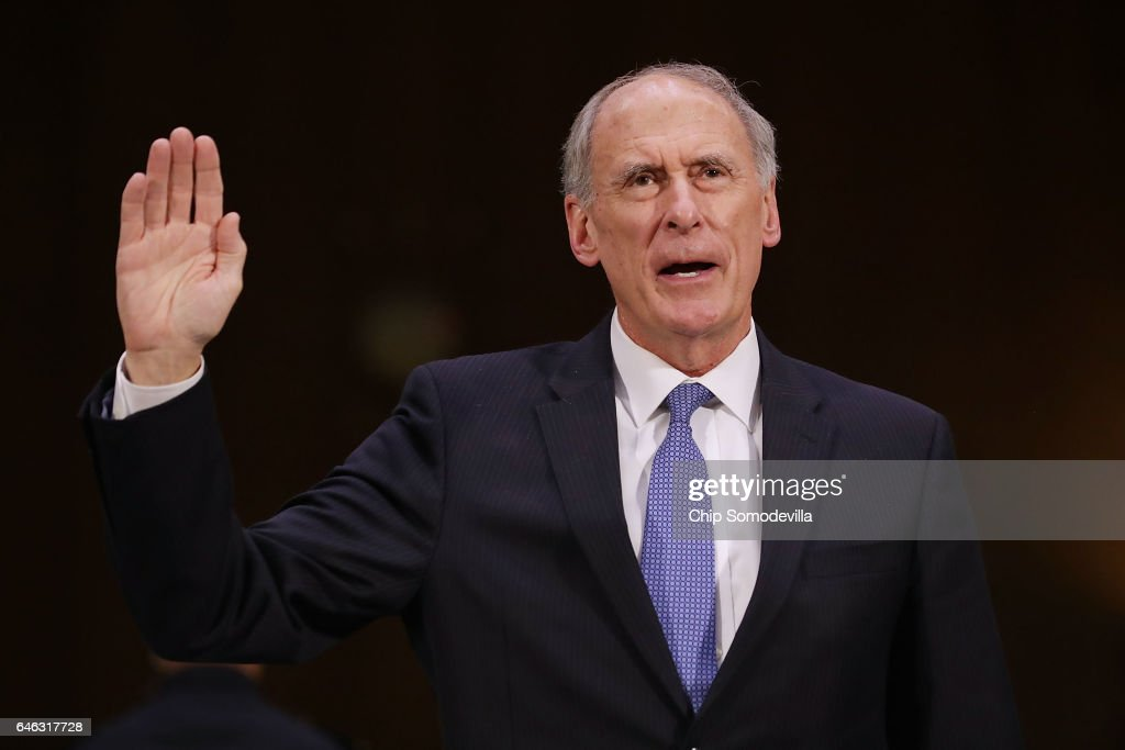 Former U.S. Senator Dan Coats is sworn in during his confirmation hearing before the Senate Select Intelligence Committee to be the next Director of National Intelligence in the Dirksen Senate Office Building on Capitol Hill February 28, 2017 in Washington, DC. A former ambassador to Germany and a two-time Republican senator from Indiana, Coats is President Donald Trump's choice to be AmericaÕs top intelligence official.