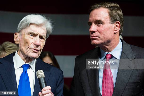 Former US Senator John Warner introduces US Sen Mark Warner during a Get Out the Vote rally for Democratic candidates November 3 2014 in Alexandria...