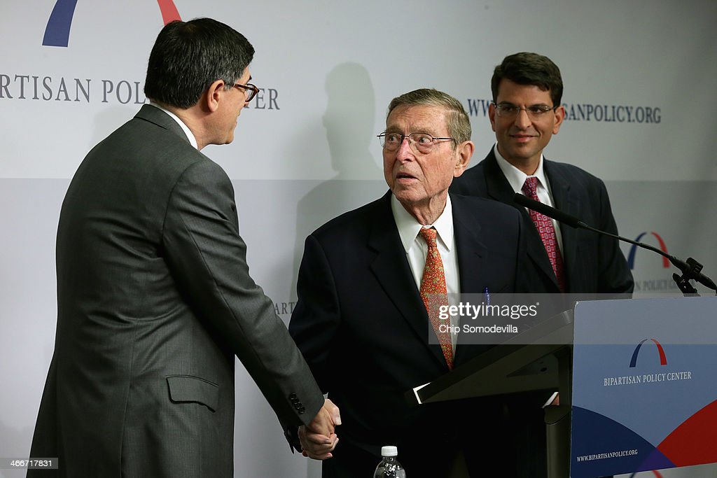 Former U.S. Senator Pete Domenici (R-NM) (C) thanks Treasury Secretary Jacob Lew after he delivered the keynote remarks and answered questions during an event about the federal debt limit at the Bipartisan Policy Center February 3, 2014 in Washington, DC. Lew urged the Congress to raise the debt limit, saying that the Treasury will have to use special steps to continue selling debt if the ceiling is not raised by February 7.