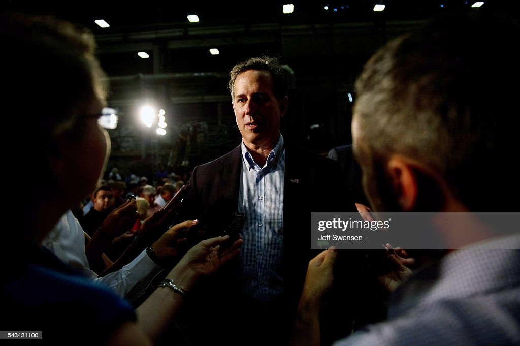 Former US Senator <a gi-track='captionPersonalityLinkClicked' href=/galleries/search?phrase=Rick+Santorum&family=editorial&specificpeople=212911 ng-click='$event.stopPropagation()'>Rick Santorum</a> was in the audience as presumptive Republican candidate for President Donald Trump speaks to guests during a policy speech during a campaign stop at Alumisource on June 28, 2016 in Monessen, Pennsylvania. Trump continued to attack Hillary Clinton while delivering an economic policy speech targeting globalization and free trade.