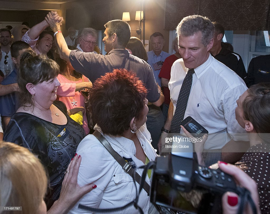 Former US Senator Scott Brown greets supporters of Republican US Senate candidate Gabriel Gomez, as Gomez shakes hands with the crowd, after a rally at the Common Market, June 24, 2013.