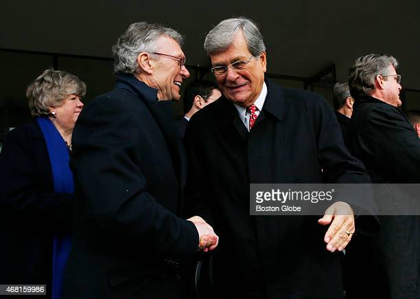 Former US Senator Tom Daschle left and former Senator Trent Lott right shake hands at the conclusion of a formal ceremony to dedicate the Edward M...