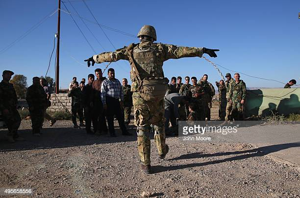 A former US serviceman instructs Iraqi Peshmerga troops on medical evacuations during a training session on November 4 2015 near the frontline with...